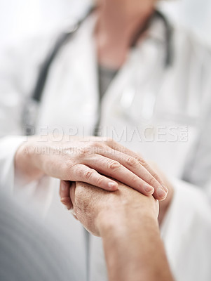 Buy stock photo Closeup shot of a doctor holding a senior patient's hand in her office