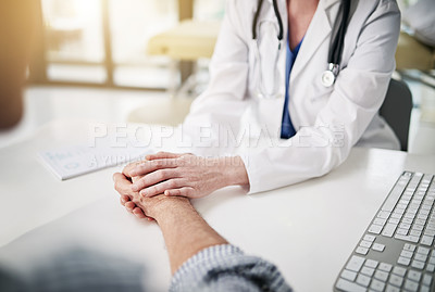 Buy stock photo Shot of a doctor holding a senior patient's hand while sitting in her office