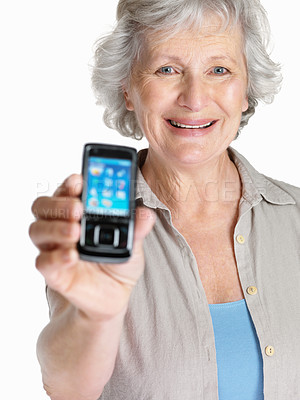 Buy stock photo Portrait of a happy mature woman showing her mobile isolated against white
