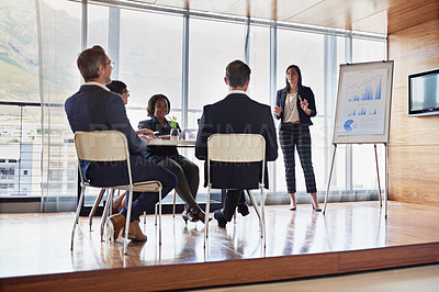 Buy stock photo Shot of a businesswoman giving a presentation in the boardroom