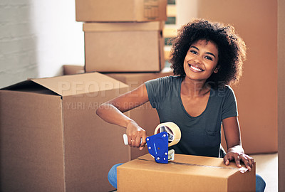 Buy stock photo Shot of a young woman busy moving house