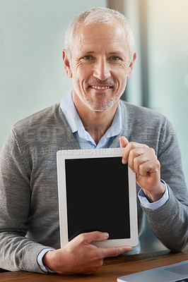 Buy stock photo Portrait of a mature businessman showing you his digital tablet in the office