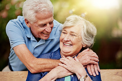 Buy stock photo Cropped shot of an affectionate senior couple in their backyard