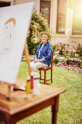 Buy stock photo Sull length shot of a senior woman posing for a painting in her backyard