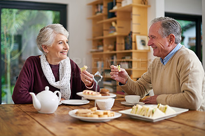 Buy stock photo Cropped shot of a senior couple having lunch at home
