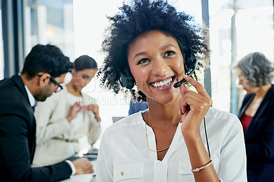 Buy stock photo Cropped shot of a friendly support agent working in an office