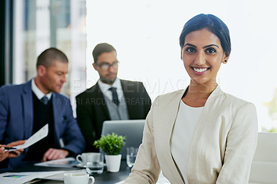 Buy stock photo Portrait of a businesswoman in an office with her colleagues in the background