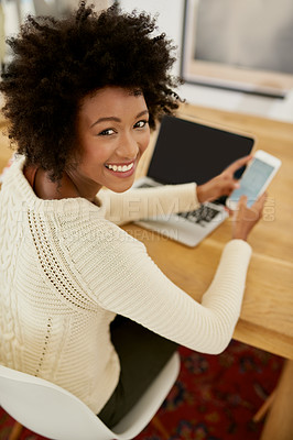 Buy stock photo Portrait of an attractive young using her cellphone and laptop at home