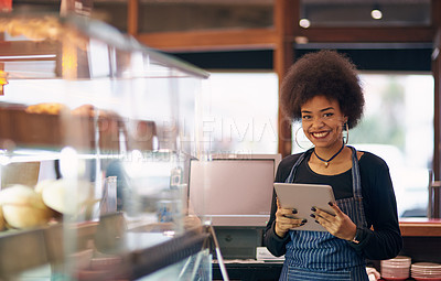 Buy stock photo Portrait of a young entrepreneur using a digital tablet in her business