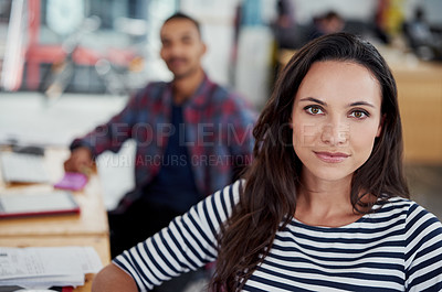 Buy stock photo Portrait of two designers sitting at their workstations in an office