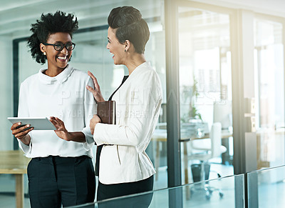 Buy stock photo Shot of two businesswomen chatting in an modern office