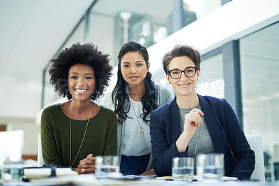 Buy stock photo Portrait of a diverse group of colleagues having a meeting together in a modern office
