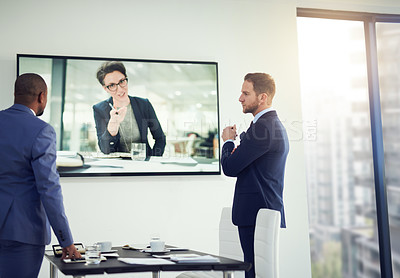 Buy stock photo Shot of a diverse team of colleagues having a video conference in a modern office