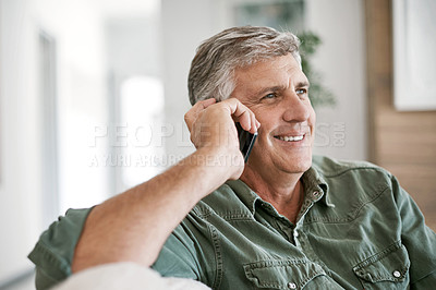 Buy stock photo Cropped shot of a mature man talking on a cellphone at home