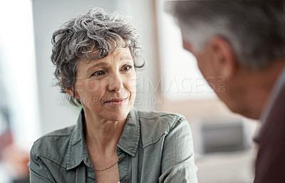 Buy stock photo Cropped shot of a mature woman having a conversation with her husband