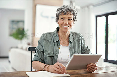 Buy stock photo Portrait of a mature woman using her tablet at home