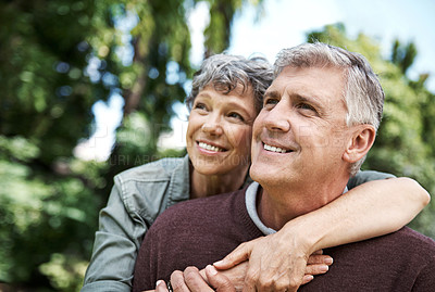 Buy stock photo Shot of a mature couple spending time together in their backyard