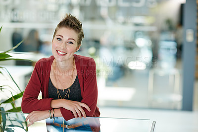 Buy stock photo Portrait of an attractive young businesswoman standing in her office