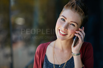 Buy stock photo Portrait of an attractive young businesswoman using her cellphone while standing on her office balcony