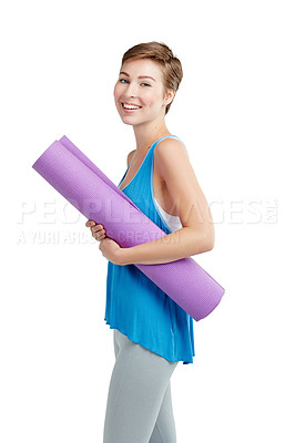 Buy stock photo Studio shot of a young woman holding a yoga mat against a white background