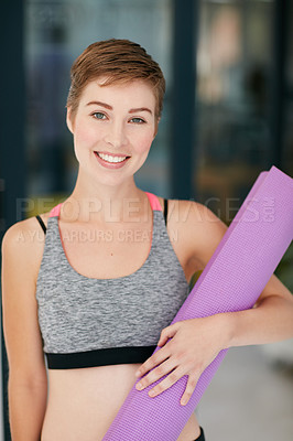 Buy stock photo Portrait of a fit young woman holding an exercise mat