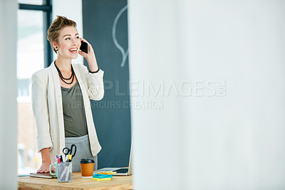 Buy stock photo Cropped shot of a young businesswoman talking on a cellphone in an office