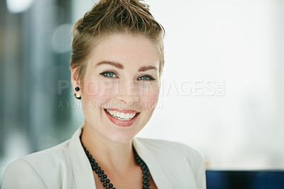 Buy stock photo Portrait of a young businesswoman sitting in an office