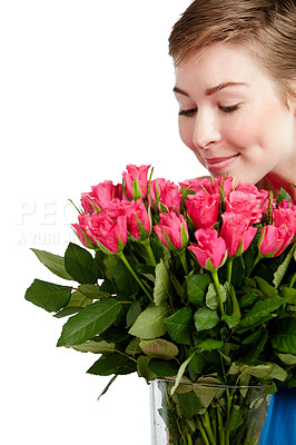 Buy stock photo Studio shot of a young woman smelling a bunch of roses