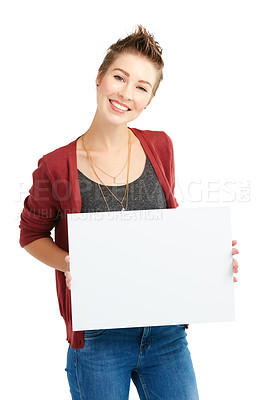 Buy stock photo Studio portrait of a young woman holding a blank placard against a white background