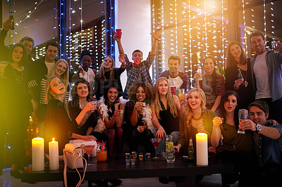 Buy stock photo Shot of a large group of young people enjoying themselves at a nightclub