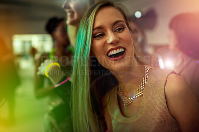 Buy stock photo Shot of a beautiful young woman dancing in a nightclub