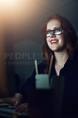 Buy stock photo Cropped shot of a young businesswoman working alone in her office at night