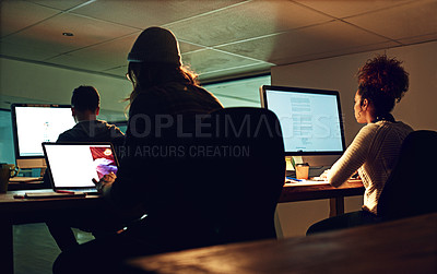 Buy stock photo Shot of a group of workers working night shift in an open plan office