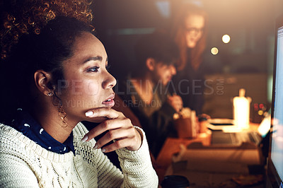Buy stock photo Shot of a young businesswoman working late in her office