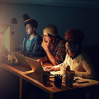 Buy stock photo Cropped shot of young employees working late into the evening
