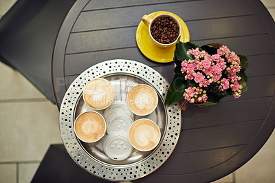 Buy stock photo High angle shot of a cafe table with four takeaway coffees on it