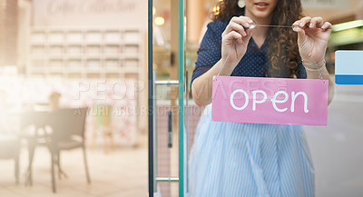 Buy stock photo Shot of an unidentifiable woman hanging an