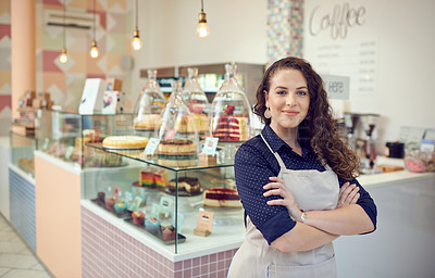 Buy stock photo Portrait of a young woman standing inside her cake shop