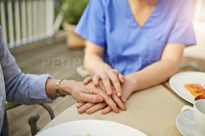 Buy stock photo Cropped shot of a female nurse holding her patient's hand