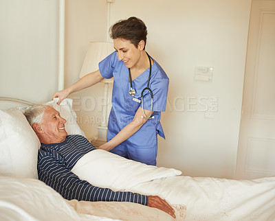 Buy stock photo Cropped shot of a female carer assisting her patient in a nursing home