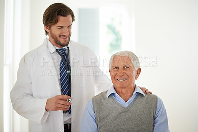 Buy stock photo Portrait of a senior patient being examined by a doctor in a clinic