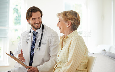 Buy stock photo Cropped shot of a doctor talking to a senior patient in a clinic