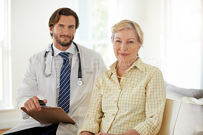 Buy stock photo Portrait of a doctor and his senior patient in a clinic