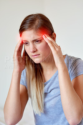Buy stock photo Cropped shot of a young woman suffering from a headache highlighted in glowing red