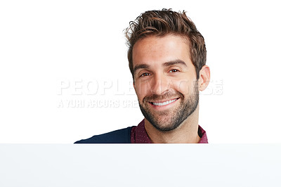 Buy stock photo Studio portrait of a handsome man holding a blank placard against a white background