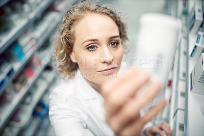 Buy stock photo High angle shot of a female chemist at work in a pharmacy