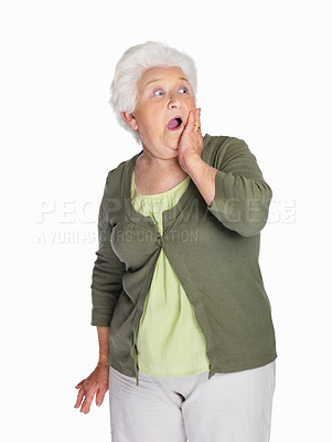 Buy stock photo Portrait of a shocked elderly female isolated against white background