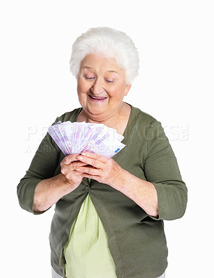 Buy stock photo Portrait of a happy senior woman holding currency notes against white background