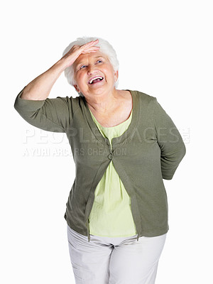 Buy stock photo Portrait of a happy senior woman shielding her eyes isolated against white