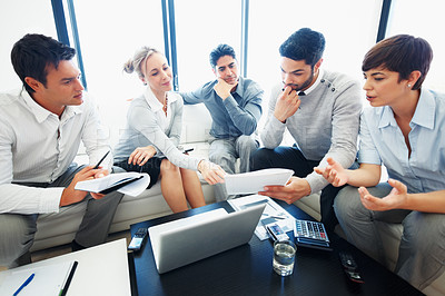 Buy stock photo Female leader discussing paper work with his team during meeting